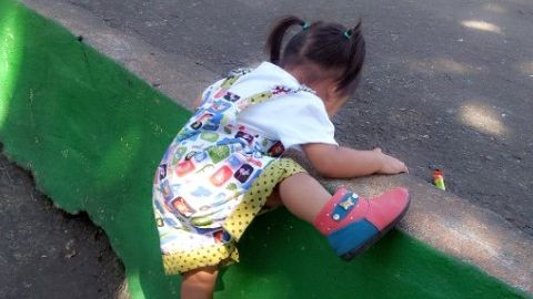 Small girl playing in reversible shortalls by Nana's Creations